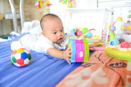 Cute Asian little baby playing with Toys