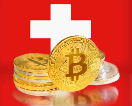 Bitcoin coins on Switzerland s Flag, Cryptocurrency, Digital money concept photo