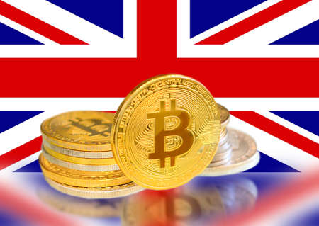 Bitcoin coins on UK s Flag, Cryptocurrency, Digital money concept photo