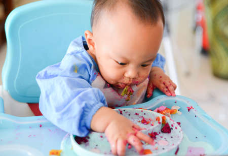 Happy eating Asian baby boy, 7 months old eating with Baby Led Weaning (BLW) method, Baby eat by himself, Self-Feeding