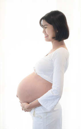 Portrait of 9 month pregnant young asian woman in white background