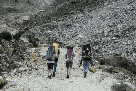 people hiking to the snow mountain Stock Photo
