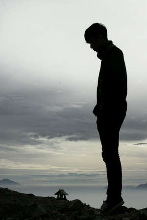 a man standing at mt.Papandayan in silhouette