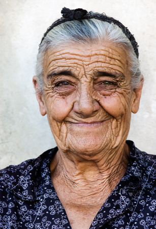 Image shows a happy old lady from a village in Greece Stock Photo