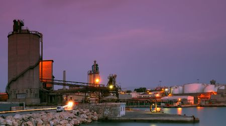 Image shows an old industrial site in Drapetsona, port of Piraeus, Greece, photographed at dusk photo