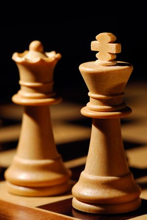 sidelit: Image shows a white chess King and Queen Stock Photo