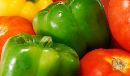 Close-up image of freshly picked tomatoes and peppers of various colors photo