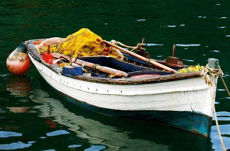 Colorful picture of a moored fishing boat full of fishing accessories