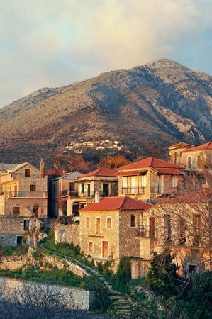 Picturesque traditional village from Mani peninsula, southern Greece, glowing in the  late afternoon light. Room for text on top