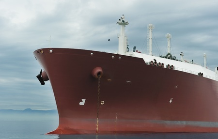 Bow of an anchored liquefied gas carrier Stock Photo