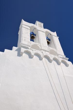 Belfry of an Orthodox church on the Greek Aegean island of Sifnos, against a blue sky Standard-Bild