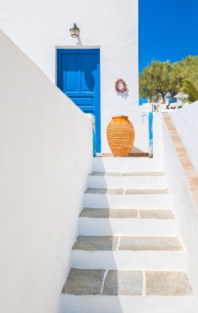 Staircase leading to an entrance with ceramic vase from the beautiful island of Sifnos, Greece Stock Photo