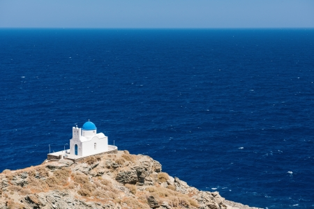 The chapel of 7 Martyrs, on the island of Sifnos, Greece, overlooking the Aegean Sea