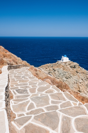 Stairway leading to the chapel of 7 Martyrs, on the Greek island of Sifnos. Stock Photo