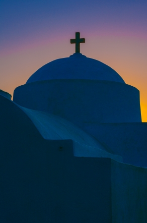 Greek chapel from Cycladic island just before sunrise, with amazing sky colors