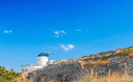 Windmill in Sifnos island, Greece, in rural setting. Space for text