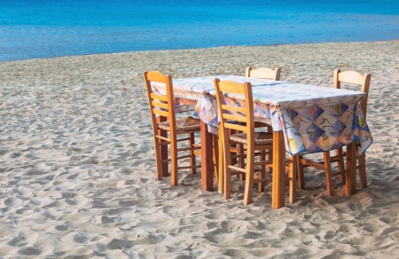 Greek taverna table and chairs on the island of Sifnos Stock Photo - 15356660