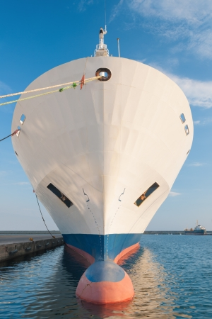 Bulbous bow of dry cargo ship docked in harbor