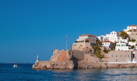 The historic entrance to the port of Hydra island, Greece