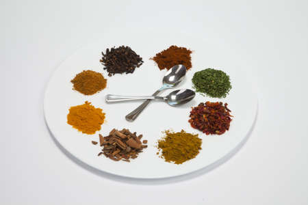 spices on a plate islated on white background photo