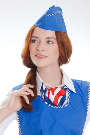 Attractive young stewardess isolated over white background photo
