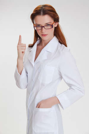 Portrait of a young girl in white  medical lab coat photo