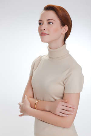 Portrait of a beautiful woman in a beige sweater photo