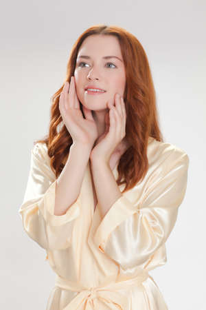 nice girl in beige home dressing gown in the moning with good mood photo