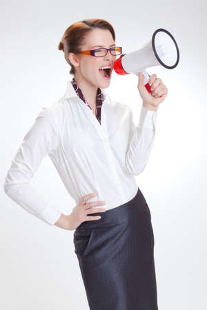business woman is screaming to her associate with megafon  isolated white background photo