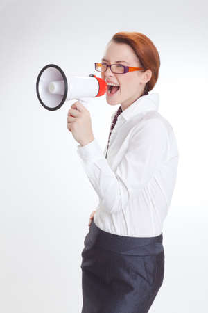 woman screaming: business woman is screaming to her associate with megafon  isolated white background Stock Photo