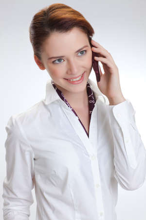 Business woman in the white blouse  isolated white background photo