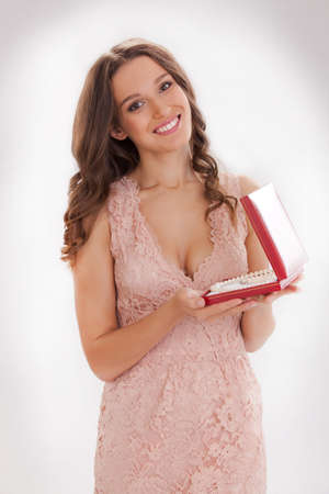 portrait of a young woman in a pink dress  happy dear gift photo
