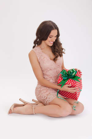 Beauty portrait of a young woman  happy dear gift  in a pink dress photo