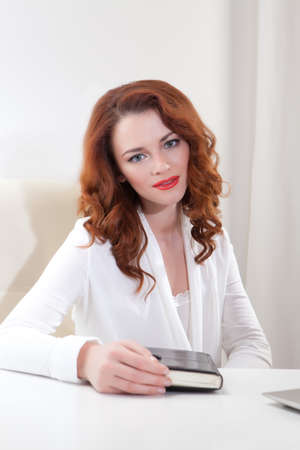 outwork: Beautiful young business woman with laptop in office