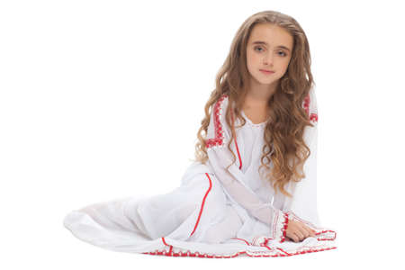 girl in white dress sitting on floor with long hair photo