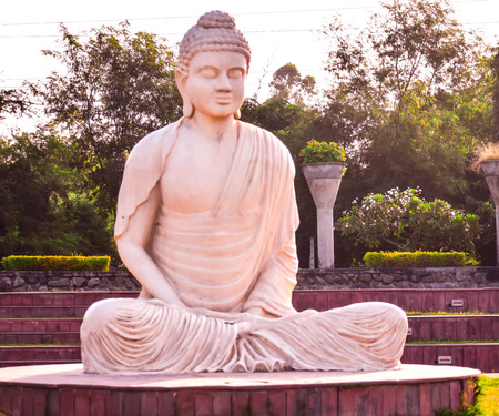 STATUE OF LORD BUDDHA IN PUBLIC PARK