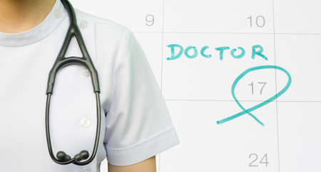 doctors with pills: A note of a doctor appointment on a calendar
