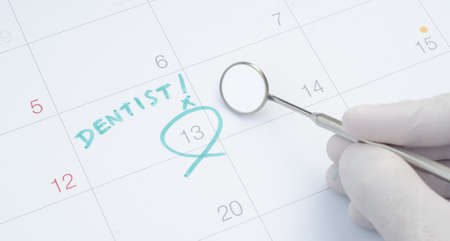 A note of a dentist appointment on a calendar, dental check up
