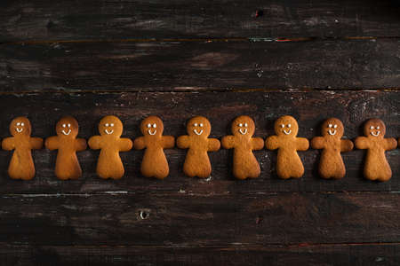Ginger Man Cookies on Rustic Wooden Table Stock Photo
