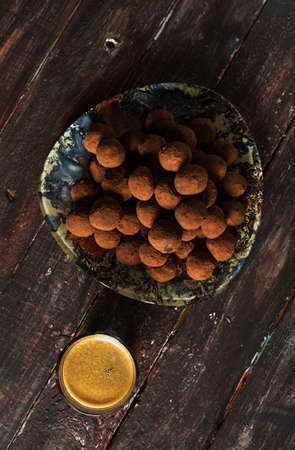 Cocoa Truffles on Rustic Background