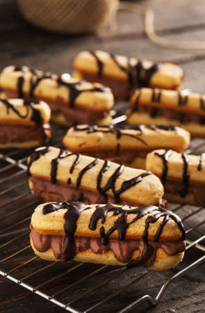 Delicious Eclair on Rustic Wooden Table
