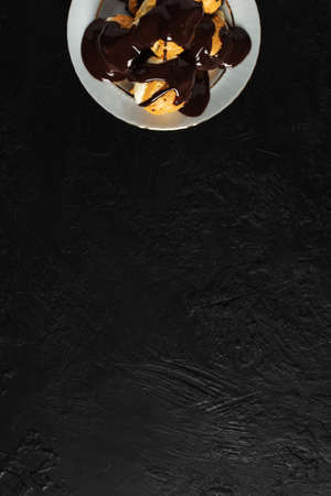 Delicious Profiterole on Wooden Table