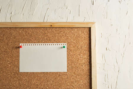 White Blank Note Attached to Corkboard Stock Photo