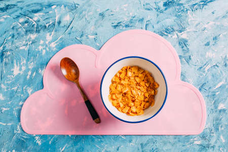 Top View Cornflakes on Blue Table Stock Photo