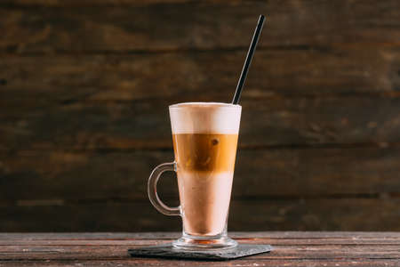 Tasty Ice Latte on Wooden Background