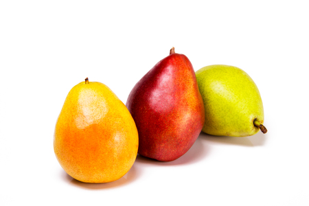 Yellow red and green pears isolated on a white background with text space. Healthy organic snacks. Stock Photo