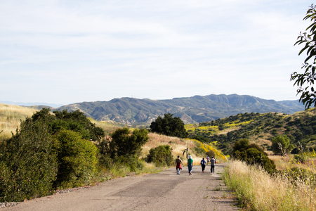 People walking on hiking trail in Irvine Open Space Park in Orange County, Southern California USA. Outdoor healthy living and exercise