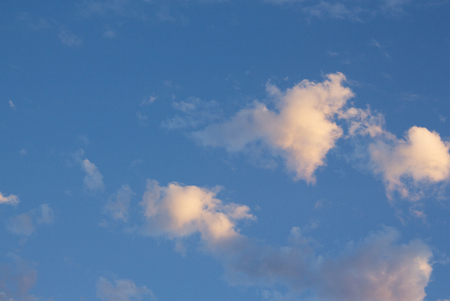 Blue sky with clouds at twilight closeup.  Background textures