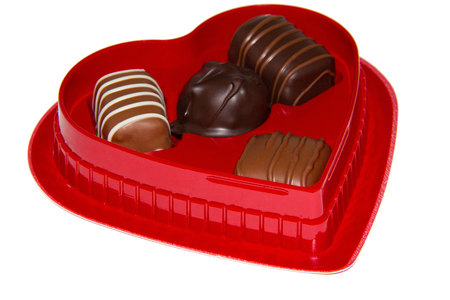 Closeup of a valentine red heart shaped box of candy Stock fotó