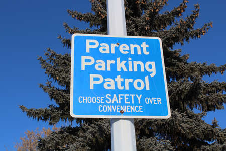 law school: Parent Parking Patrol Sign Against Tree and Blue Sky